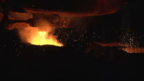 Metal is poured into the mold stock footage