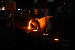 Metal Pouring worker royalty free stock image