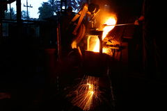 Metal Pouring worker stock images