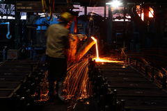 Metal Pouring worker stock photos