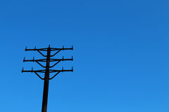 Metal power tower without wires. Old metal power tower without wires against clear blue sky Royalty Free Stock Photos