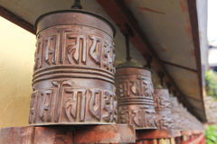 Metal prayer wheels from Buddhism Tibetan monastery of Nepal. Metal prayer wheels for meditation and praying, from Buddhism Tibetan monastery in countryside of Royalty Free Stock Images