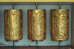 Metal prayer wheels with mantras in Dharamsala Stock Photos
