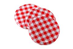 Metal preserve jar lids in Gingham pattern Stock Photos