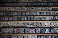 Metal printing press letters. Old vintage metal printing press letters stock images