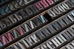 Metal printing press letters Royalty Free Stock Images