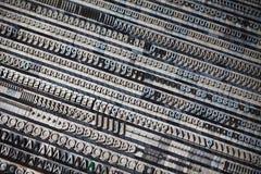 Metal printing press letters. Old vintage metal printing press letters, close-up Stock Images