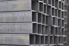 Metal profile pipe of rectangular cross section in packs at the warehouse of metal products. Russia Royalty Free Stock Photos