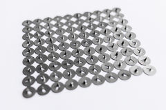 Metal pushpins on a white background Stock Photography