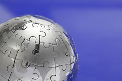 Metal puzzle globe, close-up Royalty Free Stock Photos
