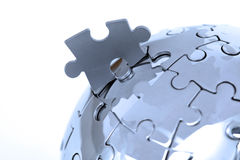 Metal puzzle globe on white background Stock Photography