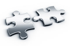 Metal puzzle pieces Stock Image