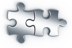 Metal puzzle pieces Stock Photography