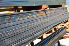 Metal quadratic profile lies in heap Stock Images