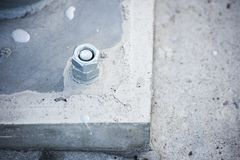 Metal rack bolted to concrete. Is close stock photo