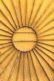 Metal Radial Sun On Orange Royalty Free Stock Images
