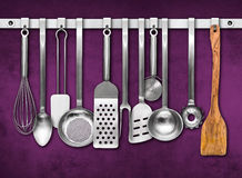Metal rail with kitchen tools Royalty Free Stock Image