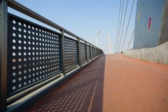 Bridge railings. The metal railing of a bridge railing casts a shadow Stock Photo