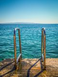 Metal railing descent to the sea Royalty Free Stock Image