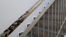 Metal railing, handrail ruined by removals. Internal staircase of a building stock footage