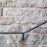 Metal railing on the old wall Royalty Free Stock Photo