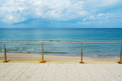 Metal railing by the shore in Sardinia. Italy Stock Photography