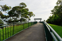 Metal railing surrounds a walkway to a lookout Stock Images