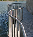 Metal railing by the water stock image