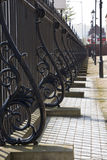 Metal Railings. Ornate cast iron railings in early evening sunlight Stock Photography