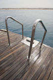 Metal railings on the back of a boat Stock Photo
