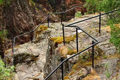 Metal railings at the cliff edge near Dorgefoss waterfall, Norway.  stock images
