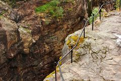 Metal railings at the cliff edge near Dorgefoss waterfall, Norway.  royalty free stock image