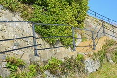 Metal railings. A photo of metal railings following a set of steps Royalty Free Stock Images