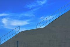 Metal railings road. Against the sky royalty free stock photo