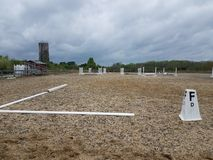 Metal railings and sand or dirt at equestrian field. Or arena stock photo
