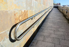 Metal railings on slope of pedestrian walkway Stock Photography