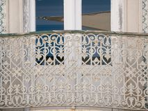 Metal railings of window balcony. Traditional Portuguese architecture house in Algarve, Portugal. Metal railings of window balcony. Traditional Portuguese royalty free stock images