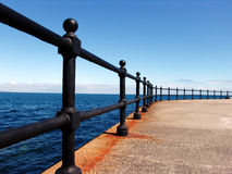 Metal rails on a beachfront. Promenade royalty free stock photo