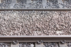 Metal Rails. Two Metal Rails with Rock Stock Photo