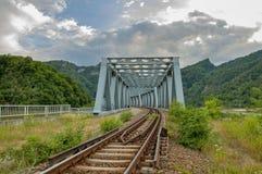 Metal railway bridge in Carpathian mountains Royalty Free Stock Image