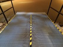 Metal ramp with yellow and black stripes Stock Images