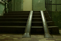 Metal ramps overlaying a flight of steps Royalty Free Stock Image