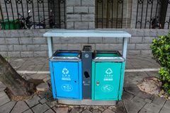Metal recycle bin on pathway royalty free stock photography