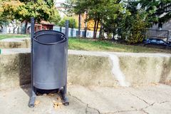 Metal recycle trash bin outside the park. Royalty Free Stock Image