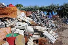 Metal recycling. Metallic waste storage for recycling - old heating radiators of cast iron and other metals refuse Royalty Free Stock Photos