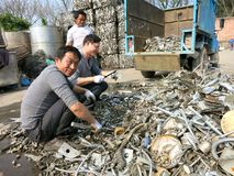 Metal Recycling - People Working in Recycling Center Stock Image