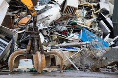 Metal recycling yard. Powerfull mechanical grabbyng arm. royalty free stock photos