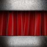 Metal on red curtain Stock Image