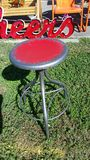 Metal Red distressed spinning Bar Stool outside Royalty Free Stock Image
