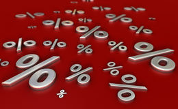 Metal reflective percent signs on a red surface Royalty Free Stock Images